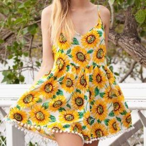 Sunflower romper with pom pom trim